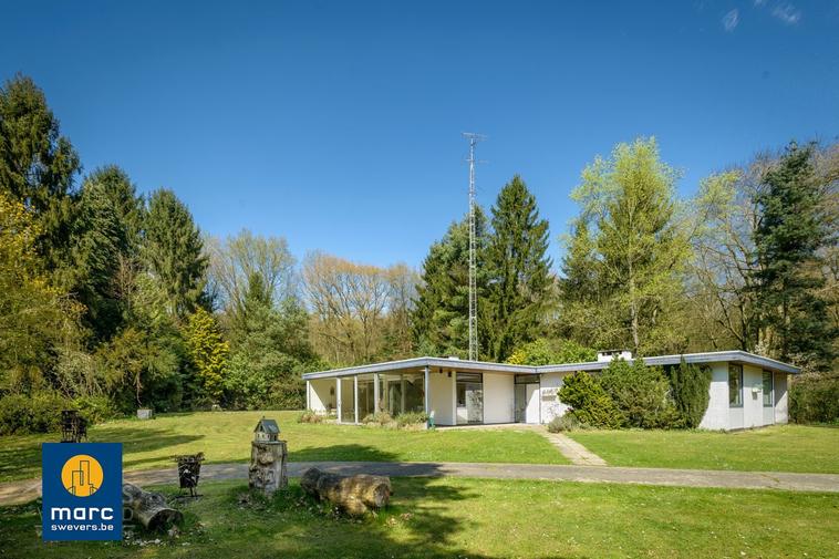 Verkocht | Bungalow woning op fantastisch stuk grond tegen natuurgebied Bolderberg