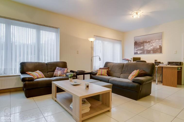 Gelijkvloers appartement met drie slaapkamers en tuintje